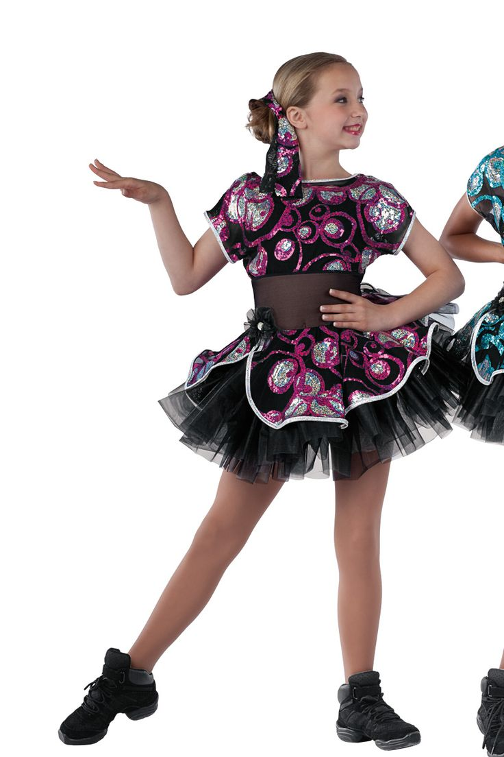 15308 She's Got The Look | Tap Jazz Funk Dance Costumes | Dansco 2015 | Black spandex short unitard with black mesh insert and sequin on black mesh overlay and attached skirt. Separate black chiffon tutu. Hologram foil printed white spandex binding and jeweled flower on pin trim. 15307-Gold 15308-Fuchsia 15309-Peacock Headpiece included.