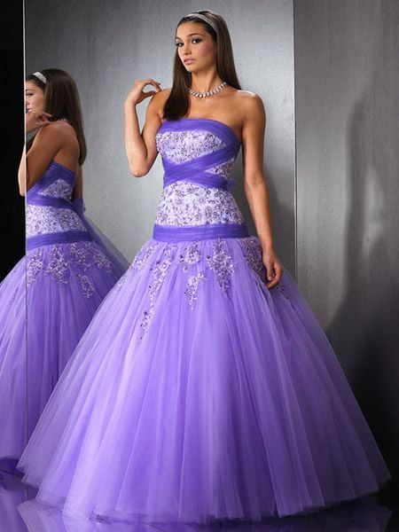 Long and flowing, this prom dress is made for the belle of the ball.  The deep purple is an excellent accent across the bodice, the jewels sure don't hurt either!