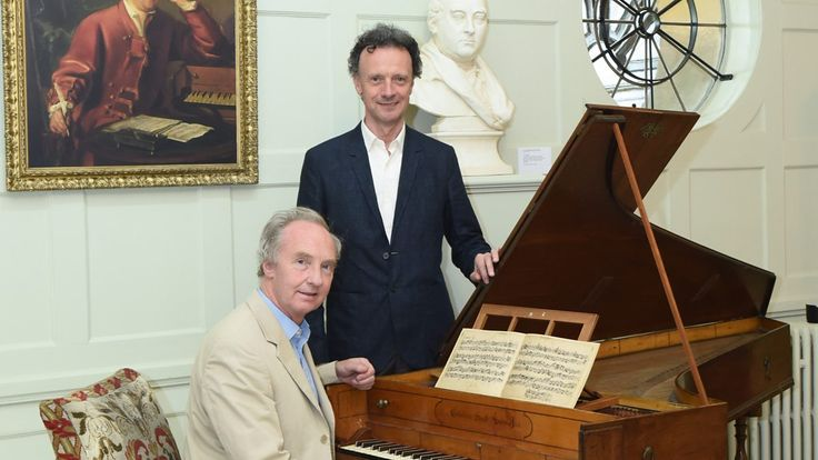 Duke of Buccleuch at Handel's harpsichord, with curator Paul Boucher at Boughton House. (1200×675)