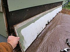 Replacing water-damaged hardboard wood siding.