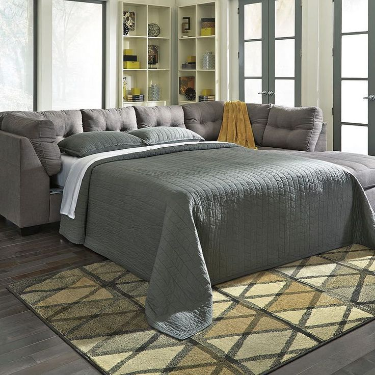 That Furniture Outlet - Minnesota's #1 Furniture Outlet. We have exceptionally low everyday prices in a very relaxed shopping atmosphere. Ashley Maier Charcoal Sectional Sleeper thatfurnitureoutlet.com #thatfurnitureoutlet  #thatfurniture  High Quality. Terrific Selection. Exceptional Prices.