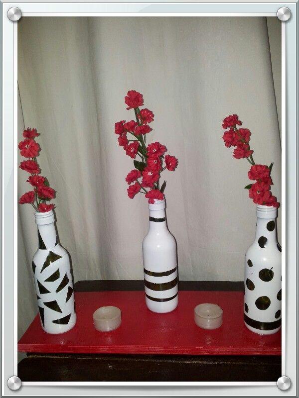 Mini botellas de vino con velas decorativas