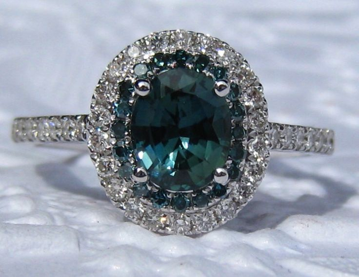 Teal Sapphire and Blue Diamonds in White Gold Diamond Halo Engagement Ring, Blue Sapphire Engagement Ring by JuliaBJewelry on Etsy https://www.etsy.com/listing/289542411/teal-sapphire-and-blue-diamonds-in-white