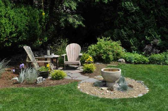 Nice small seating area.  Remove lower deck, add path to pine tree, put underneath and on a floating deck or gravel.