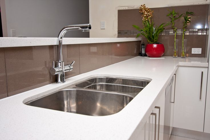 An undermounted kitchen sink makes wiping the bench so much easier. www.onecallkitchens.com.au