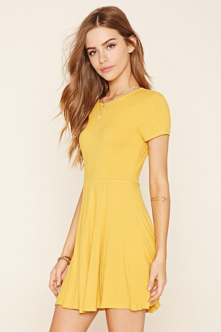 A ribbed knit skater dress featuring a cutout back and short sleeves.