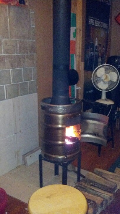 Guinness keg wood stove. Such a clever husband( My wife pinned this when I built it) Love this thing.