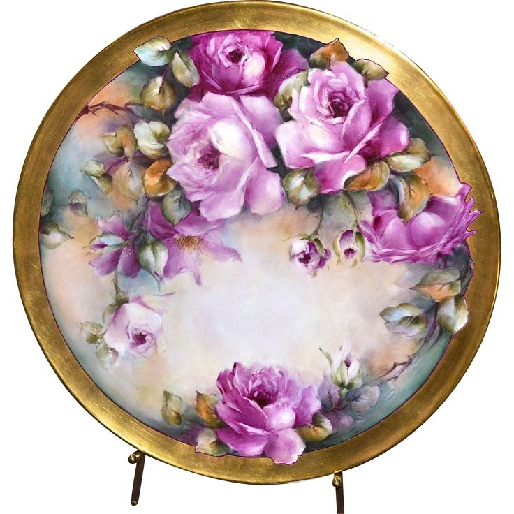 I am delighted to offer for your consideration an absolutely fabulous Limoges rose filled tray or hanging wall plaque.  The piece bears the Tressemann