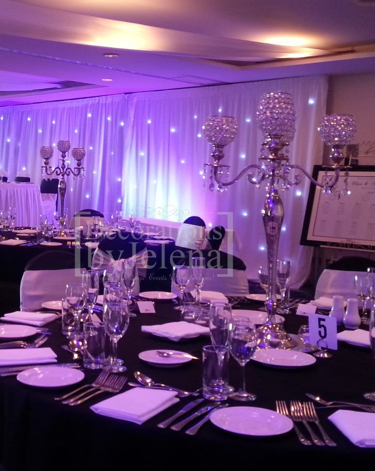 Black and white elegant wedding reception with silver and crystal candelabra centerpiece  by Decorations by Jelena