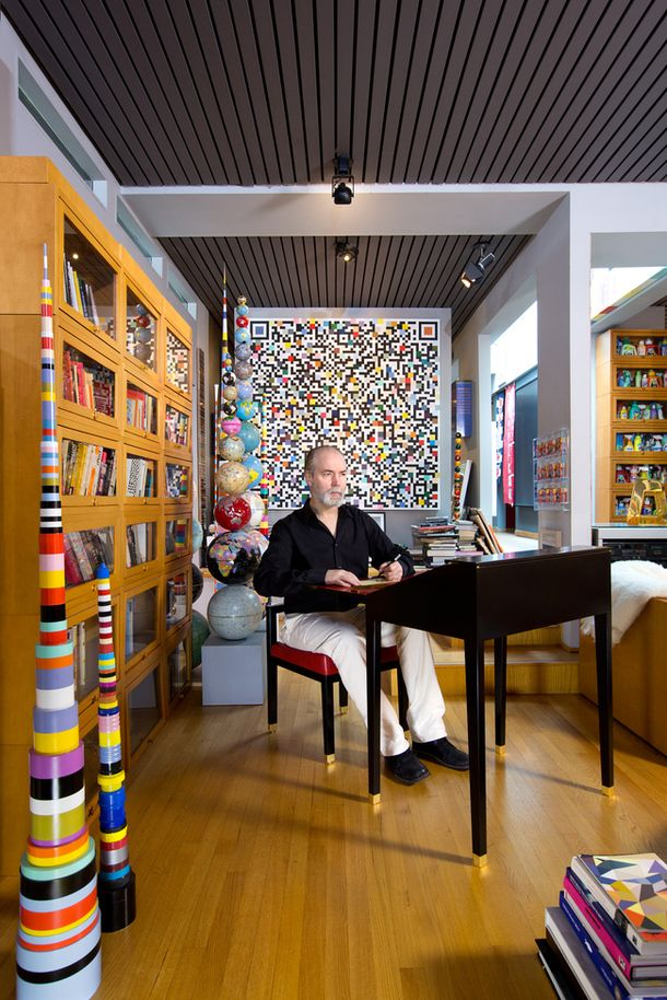 Douglas Coupland at an escritoire, which he designed for SwitzerCultCreative. But, really, those cabinets are just the limit.