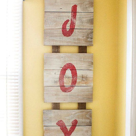 This rustic Christmas sign is made from repurposed fence board, a stencil and paint.