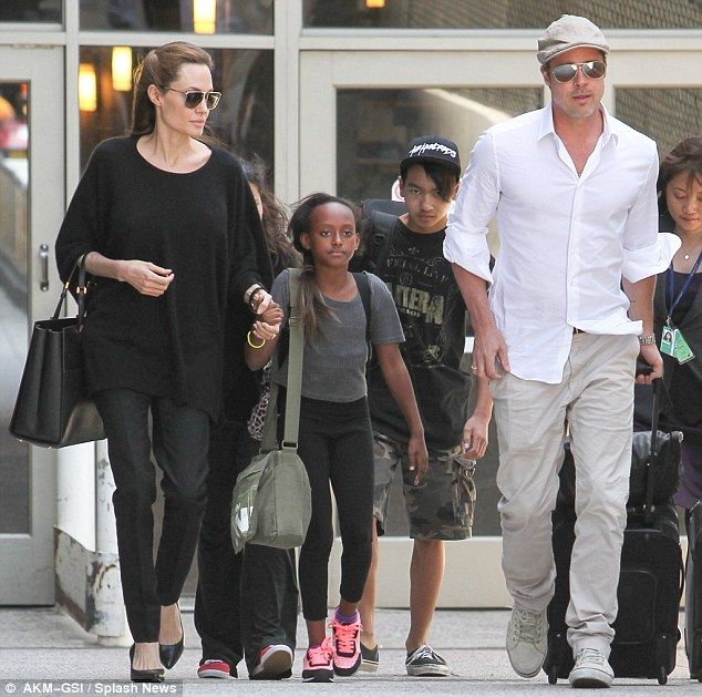 Family getting bigger? Angelia Jolie and Brad Pitt, pictured above with adopted children Maddox and Zahara, could be set to adopt a child from, Syria