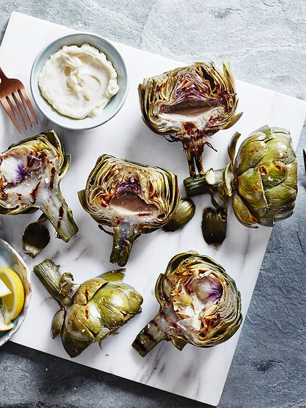 These charred artichokes with preserved lemon aïoli make a great veggie starter or snack. Adding preserved lemon to the aïoli gives it a great, zesty kick.