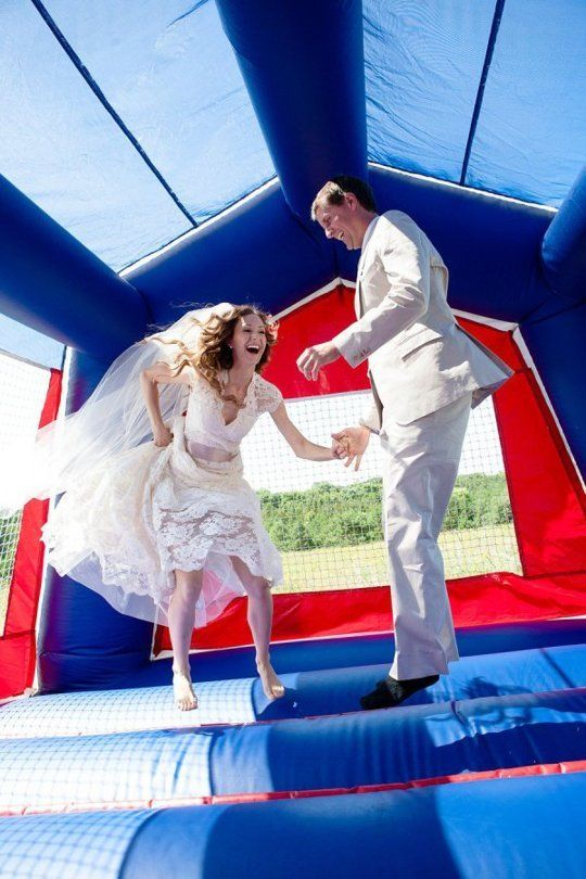 "Let's face it–some weddings can be, well, boring (especially if you're not the dancing type). You're probably happy to be there, just to support the couple as they commit their lives to each other forever. But sometime between the rubbery chicken dinner and the encore performance of the Cha Cha Slide, you're bound to be sitting there thinking to yourself, ""This wedding would be so much better if there was a bounce house."""