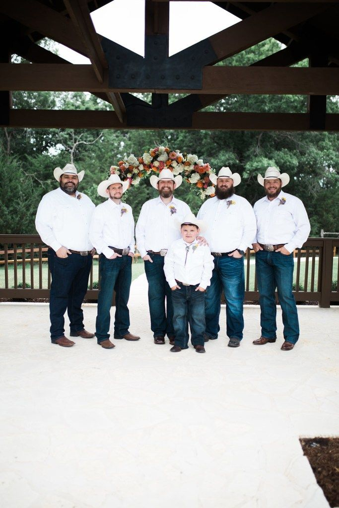 Handsome country groomsmen in jeans + boots!  Love this groomsmen look for a casual wedding.  Looking so great in their cowboy hats + boots! Photo taken at THE SPRINGS in McKinney, Stone Hall.  Follow this pin to our  website for more information, or to book your free tour! Photographer:  Texas Sweet Photography #groomsmen #groomsmenideas #countrywedding #countryweddingideas #southernwedding #texaswedding #casualwedding #weddingdetails