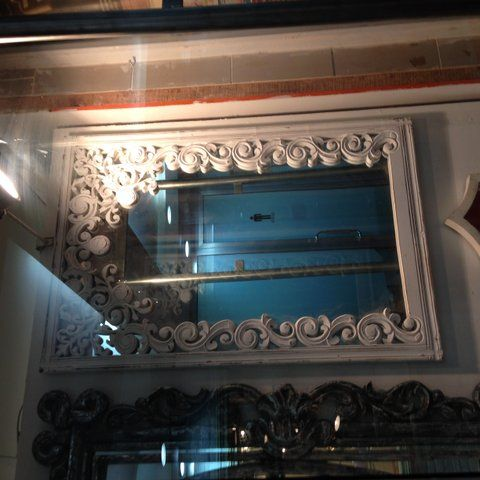 We love this uniquely bordered mirror - wood painted white!   Mirror mirror in the wall!   To purchase or enquire email us: info@handmadeworld.in  or call us: +91 9899440144 (India)