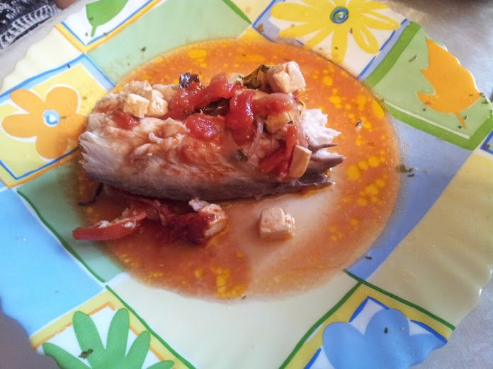 Fish in the oven with feta cheese and tomatoes