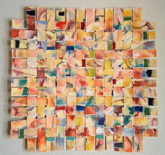 + opdracht compositie: overrall compositie. Meng met je verf allerlei kleuren en schilder ze op een vel papier. Het hoeft niets voor te stellen (abstract). Laat het werk drogen en snijd of knip er stroken van gelijke breedte van. Nu kun je vlechten, denk even terug aan groep 1&2 je weet vast nog wel hoe dit moet. Je hebt een overall compositie gemaakt.