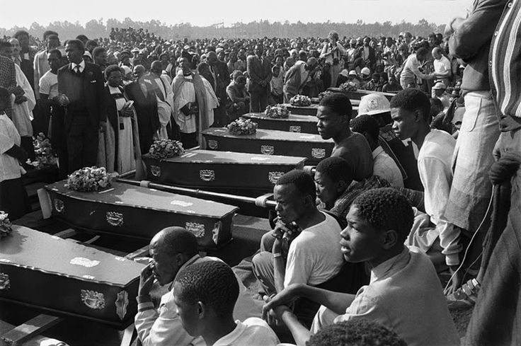 Coffins at a mass funeral held in KwaThema, Gauteng, July 23, 1985. © Gille de Vlieg.