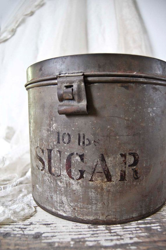 Sweet round sugar tin. Wonderful patina from age. Simple stencils add a modern graphic punch. I love the cool industrial style latch. Some slight