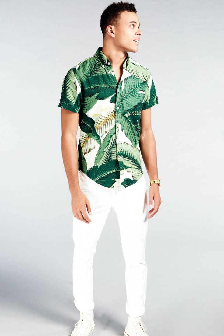 Channel west coast cool with this palm tree-print shirt. A standout piece  for