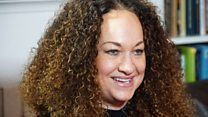 """Media playback is unsupported on your device Media caption""""The idea of race is a lie"""" – Rachel Dolezal speaks to Emily Maitlis The US race activist Rachel Dolezal, who identifies as black despite being born white, is to visit South Africa to talk about her..."""