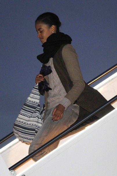 Malia Obama, daughter of U.S President Barack Obama and first lady Michelle Obama, steps off Air Force One at Andrews Air Force Base near Washington, January 3, 2012. The first family returned to Washington from their Christmas and New Year vacation. (via Photo from Reuters Pictures)
