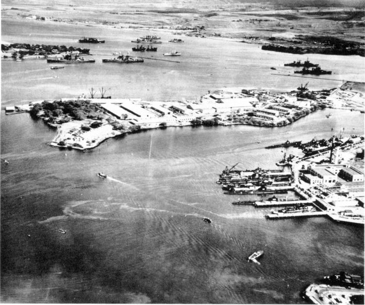 Southeast Loch of Peal Harbor Naval Base, Oahu, Hawaii, Oct 13 1941. The Submarine Base finger piers (right), Supply Depot (center), last 2 berths of Battleship Row (upper left), and East Loch anchorage (upper right). (Hawaiian Aviation Archives)