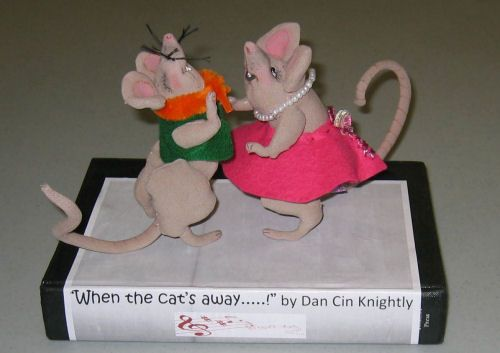 """Ragtime Rats  Standing at 5"""" tall (not counting the tail!)  by Sharon Mitchell While the cat's away, these Ragtime Rats are having a ball, swing dancing amongst the books!  Dress them in different colours – a bow tie, hats, sunglasses, to name but a few of the ways you can express yourself with these quick and easy dolls. Dress them for Christmas, Easter or any holiday! Make them as a Christmas tree ornament or a fairy mouse with a tutu and a wand!  An armature helps them stand alone. The…"""
