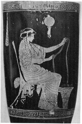 Woman working wool, seated before kalathos