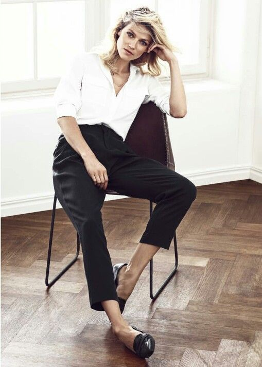 White blouse, black ankle length trousers, and black loafers