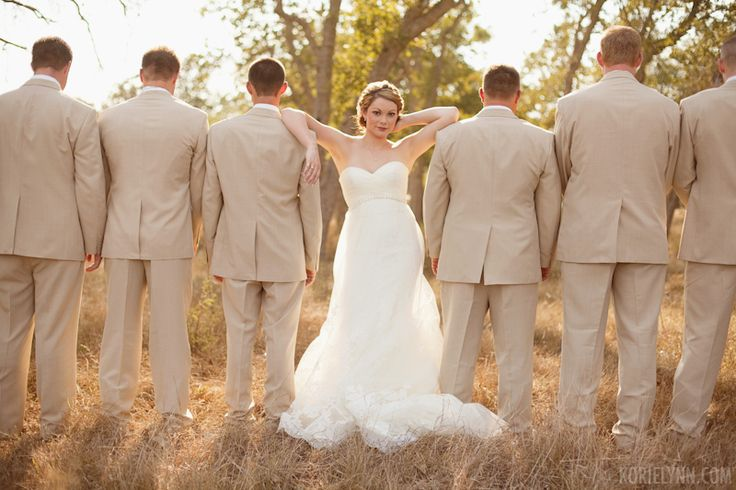 Great Bride with the groomsmen photo Idea!