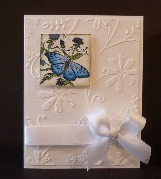 Embossed card with butterfly