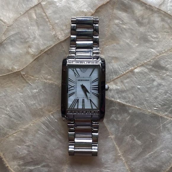 Emporio Armani AR3169 Ladies Watch 100% authentic Emporio Armani Ladies watch. Stainless steel bracelet with mother of pearl face. Authentic diamonds issued by Emporio Armani. Emporio Armani Accessories Watches