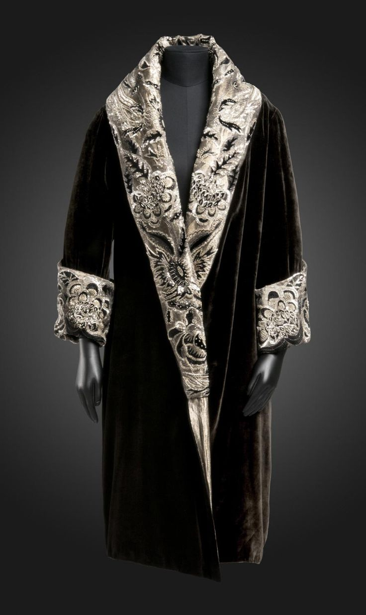 Evening Coat  Label Anart, Paris  Geography: Made in Paris, France, Europe Date: c. 1923-28 Medium: Black silk velvet; metallic thread and cotton twill (lamè); rayon embroidery in chain stitch; silk velvet appliqués; beads and sequins Dimensions: Center Back Length: 44 inches (111.8 cm) Accession Number: 1971-60-1 Philadelphia Museum of Art