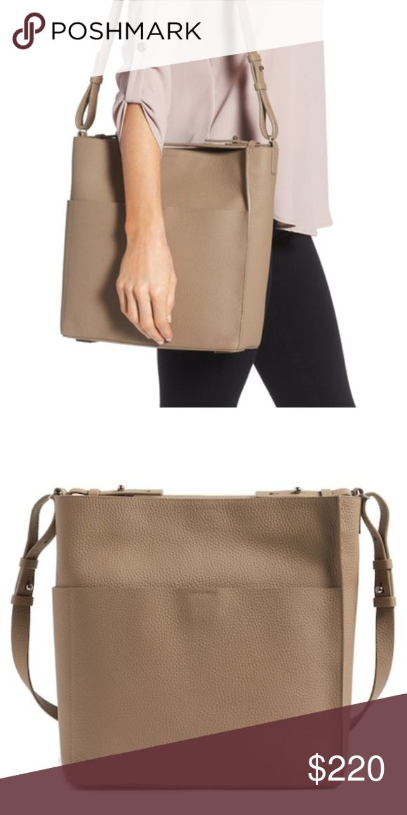AllSaints Mast Shoulder Tote Authentic NWT and dust bag AllSaints Mast N/S Shoulder Tote in Mushroom Grey (dark taupe).  Minimalist styling merges with maximum versatility on a pebbled-leather tote featuring a spacious exterior pocket and multiple carrying options, thanks to its detachable top handle and shoulder strap. - Hidden magnetic closure - Optional, adjustable top handle; optional, adjustable shoulder strap - Exterior slip pocket - Interior zip, wall and smartphone pockets - Lined…