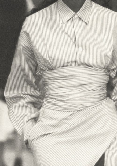 cotonblanc:   Summer 1986Cour Carrée du Louvre Asymmetry breaks the rules for white and striped shirts. Being oversized, they wrap, tie together, and sculpt a body with broken-offset lines. An exercise of style that generously embraces two cultures.  Talking to Myself, Edited by Carla Sozzani and Yohji Yamamoto