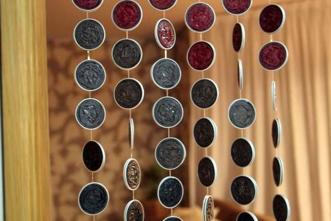 Crushed Nespresso pods can be made into a colorful decorative curtain for your home.