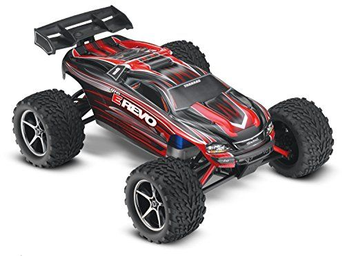 E-Revo: 1/16-Scale 4WD Racing Monster Truck with TQ 2.4GHz Radio, Red:   The 1/16 E-Revo is about half the size of the 1/10-scale E-Revo, but still delivers all the quality and capability you expect from Traxxas. Beneath the factory-finished polycarbonate shell, you'll find the suspension technology of the eight-time National Champion Traxxas Revo.  The huge torque of the 1/16 Revo's Titan 550 motor provides unstoppable performance! The Titan's cooling fan pulls air through the motor f...