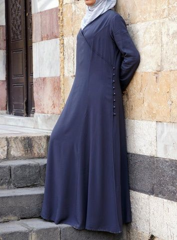 Hearts Desire Abaya Storm color A SHUKR favorite if ever there was one, the regal drape and flow of this exquisite abaya will be your heart's desire. Superbly designed, this piece's luxuriously soft fabric and feminine wrap and button detail will have you dressed like a queen in modest beauty.
