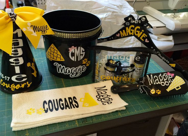 Cheerleader gifts for cheer camp  PERSONALIZED : bucket to fill up with gifts, sweat towel, paddle brush, cosmetic bag filled with necessities, cheer spirit uniform hanger, mini megaphone and cheer bow