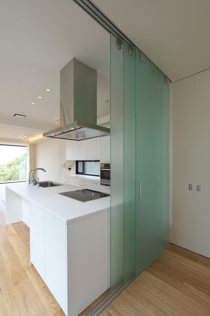 Slide glass divider - great for hiding the kitchen when you've got guests