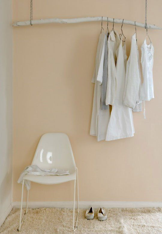 If yesterday's chain DIY clothes rack was too industrial for your taste, here's something a bit more...rustic: Find a branch outside, paint it white, and then loop it through two chains and hang it from the ceiling.  Definitely a more traditional clothes rack; and in the right place, it would look pretty inventive (especially if there was this wallpaper behind it perhaps?).