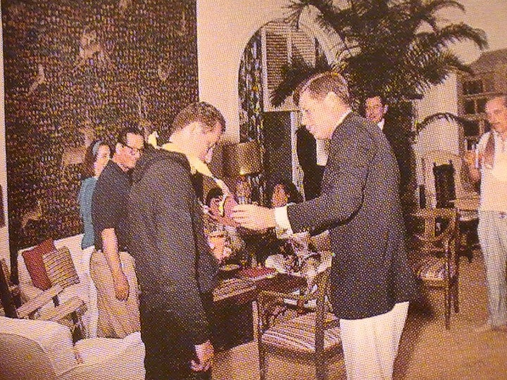 Clint Hill receiving an award from JFK as Dr Feelgood looks on