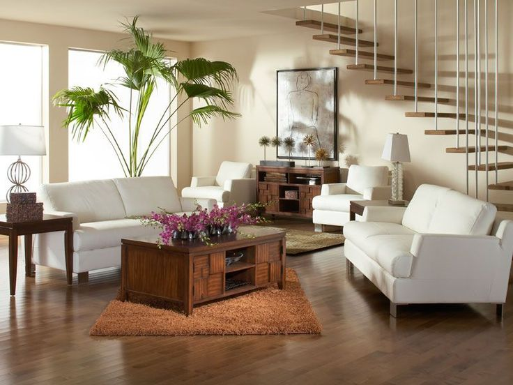 the white leather of the luca sofa and matching chair magnifies space adding depth and student livingliving room - Matching Chairs For Living Room