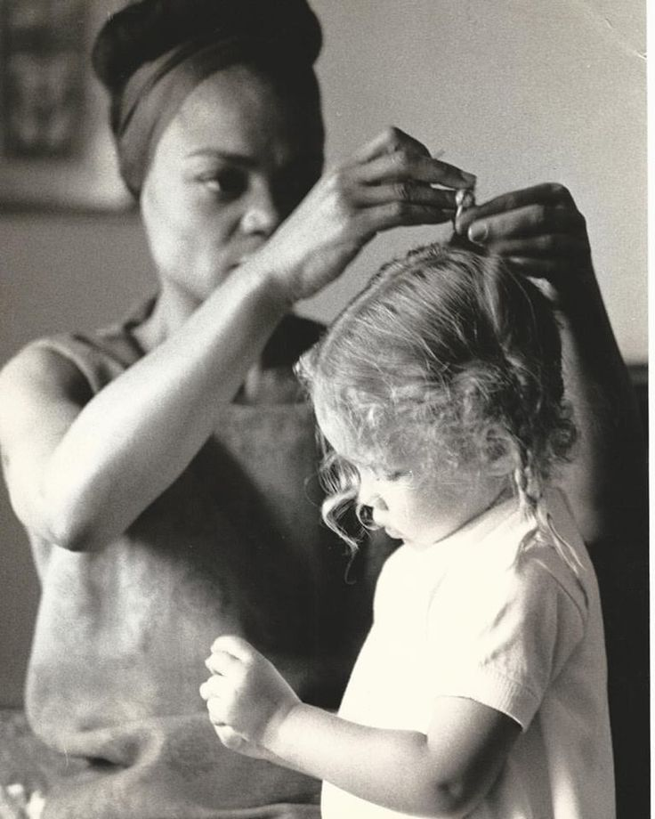 It's time to get ready for the day. Eartha Kitt putting pigtails in daughter Kitt Shapiro's hair.