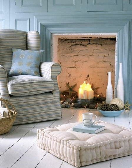Love the cushion that goes in front of the fireplace....I imagine this room off the coast of Maine :)