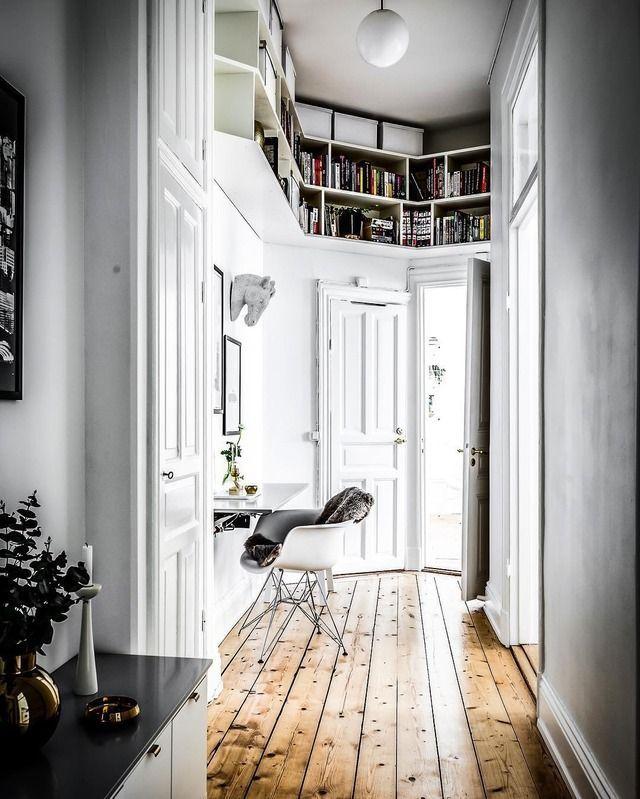 white interior, natural hardwood floors