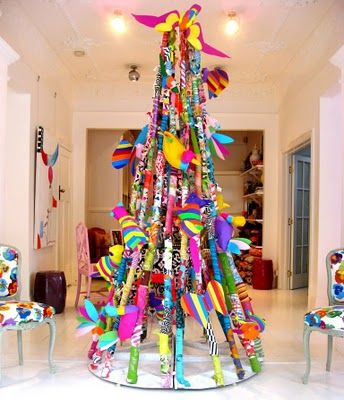 contemporary christmas art tree installation (DIY: large hoop at floor w/ attached lengths of clothes line strung w/ decorated toilet paper tubes gathered & hung from ceiling hook; attach twinkle lights)--  absolutely beautiful things