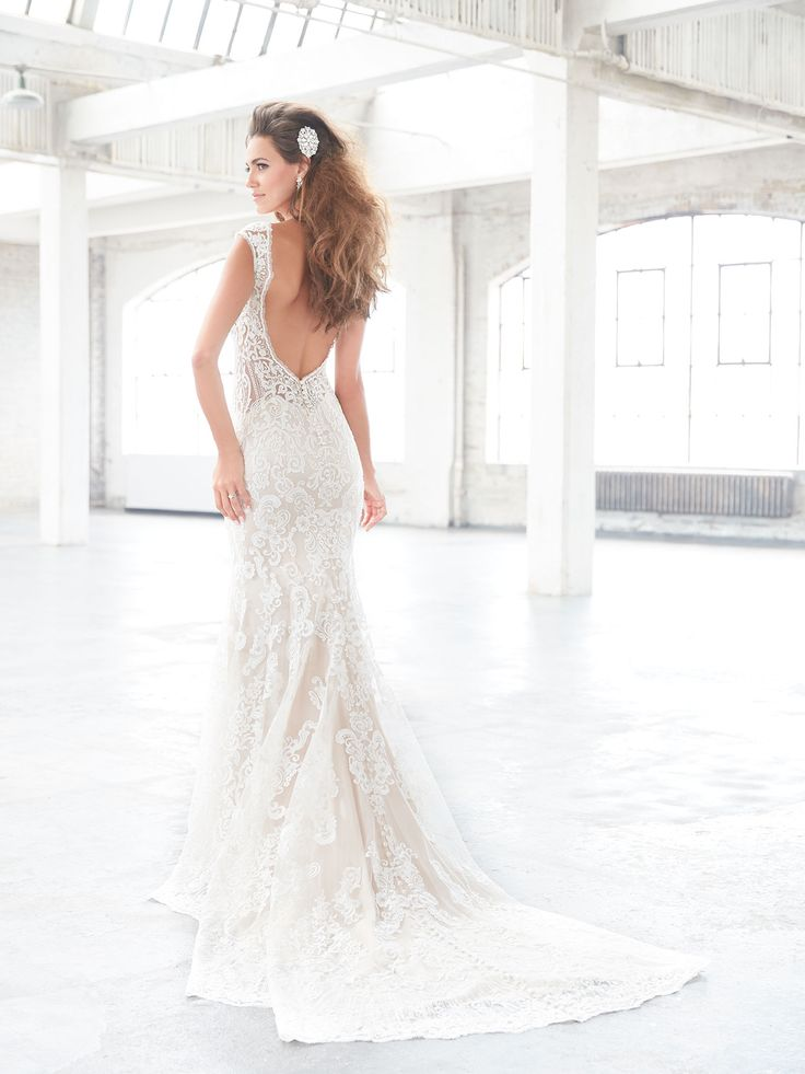 Fancy Madison James Bridal Gowns available at Nikki us Glitz and Glam Boutique
